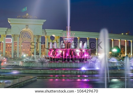 Night long exposure image of big fountain in National Park of first President of Kazakhstan, Almaty. - stock photo