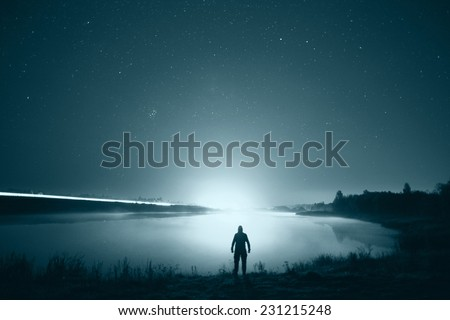 night man at Lake starry sky space alien - stock photo