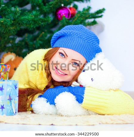 Night New Year.Woman with teddy bear.Christmas in room - stock photo