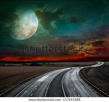 Night of the highway and huge moon - stock photo