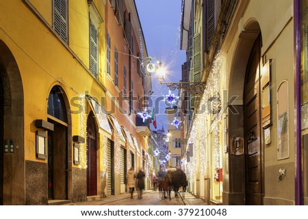 Night old city illuminated for holidays, Parma, Italy. - stock photo