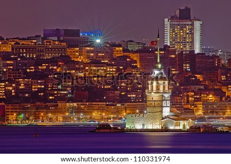 Night on Maiden or Leander's Tower at Istanbul as seen from Uskudar - stock photo