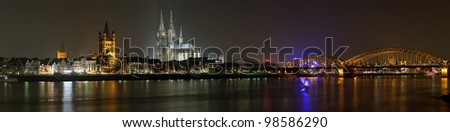 Night panorama of Cologne with Great St. Martin Church, Cologne Cathedral and Hohenzollern Bridge from bank of the Rhine river, Germany - stock photo