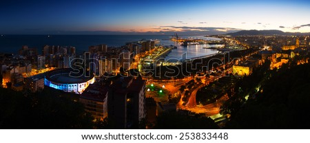 Night panorama of  Malaga with Port and Placa de Torros from castle.  Andalusia, Spain - stock photo
