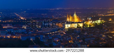 Night panorama of Prague, Czech Republic. Castle, St. Vitus Cathedral. Panoramic night view to Lesser Town, Prague castle and St. Nicholas church. UNESCO heritage sites - stock photo
