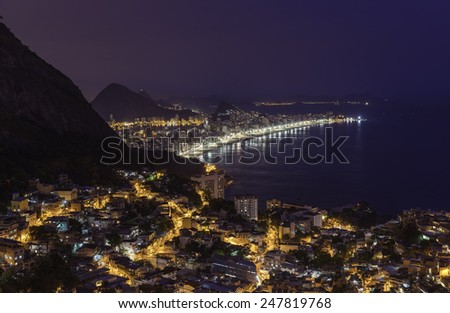 Night panorama of Rio de Janeiro with water reflections, Brazil - stock photo