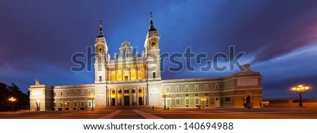 Night panorama of Santa Maria la Real de La Almudena is Catholic cathedral in Madrid. Spain - stock photo