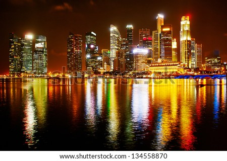 Night panorama of Singapore downtown. There are more than 7,000 multinational corporations from United States, Japan and Europe in Singapore. - stock photo
