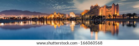 Night panoramic view on northern beach of the Red Sea in Eilat � famous resort and recreation town in Israel   - stock photo