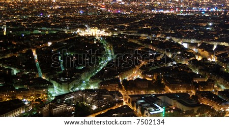 Night Paris seen from 300 m above ground, from the top of the Aiffel Tower, with the Arc de Triumph glowing at the back