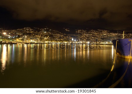 Night photo of a city by the sea in Funchal