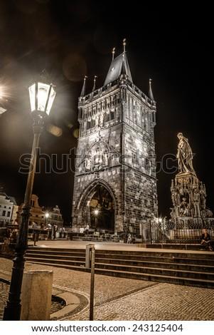 Night photo of Lesser Bridge Tower at Charles Bridge ,Prague,Czech Republic  - stock photo