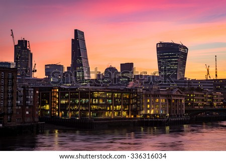 Night photo of London silhouette, offices by the Thames river and the new skyline
