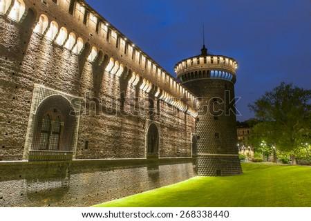 Night photo of Sforza Castle (Castello Sforzesco) in Milan, Italy  - stock photo