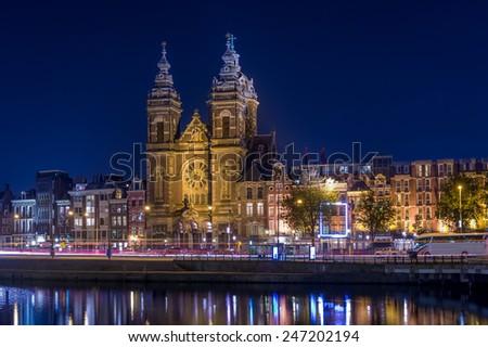 Night photo of St. Nicholas church in Amsterdam - stock photo