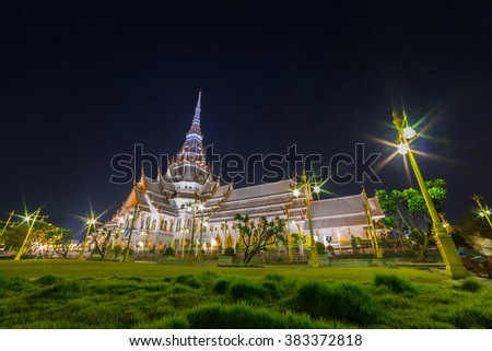Night photo of Wat sothornwararam (Thai temple) during Magha Puja day, the one of important day for Buddhism religion. This place is public famous place for traveler in Thailand.   - stock photo