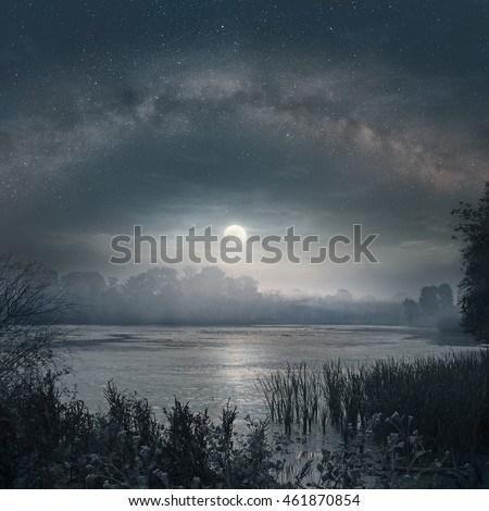 Night picture of Milky Way and rising Moon over the lake