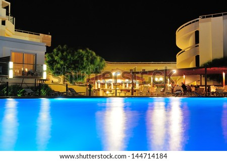 Night pool side of rich hotel - stock photo