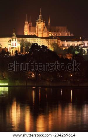Night Prague gothic Castle above River Vltava, Czech Republic - stock photo