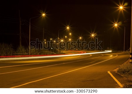Night Road at suburban with the light trails car  - stock photo