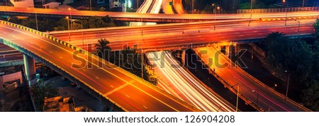 Night road intersection - stock photo