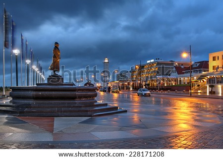 Night scene along the waterfront promenade in the resort-town of Noordwijk, The Netherlands during a stormy evening. - stock photo