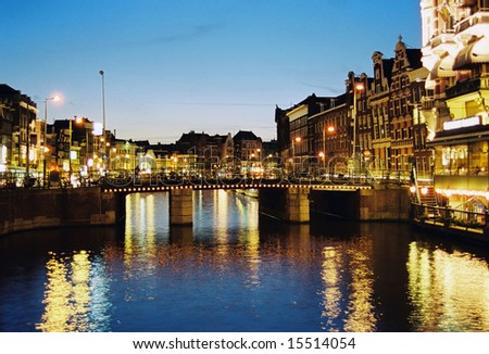 Night scene in one of central canals in Amsterdam