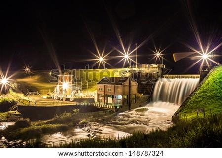 Night Scene of a small hydroelectric plant in rural Brazil - C�¢ndido Mota, SP - Pari-Veado river - stock photo