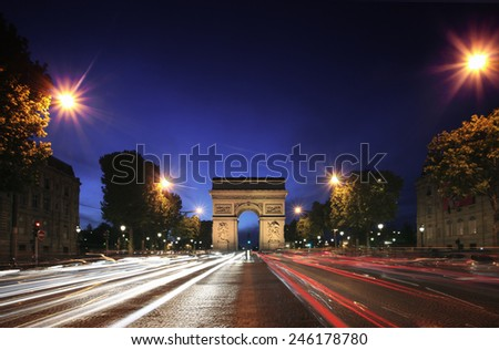 Night scene of Arch de Triumph in Paris. - stock photo