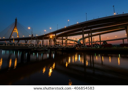 "Night Scene of Bhumibol Bridge at dusk in Bangkok, Thailand. Foreign text on the bridge is the bridge name ""Bhumibol 2"""