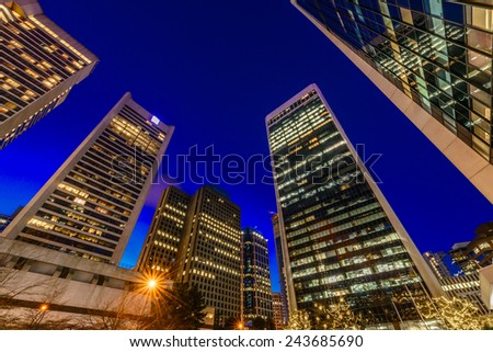 Night scene of colorful city life with skyscrapers, highrise buildings. Vancouver downtown  at night. - stock photo