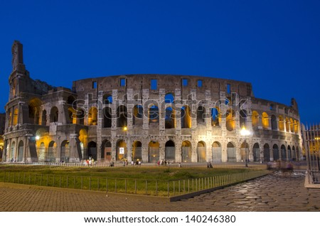 Night scene of Colosseum in Rome, one of the seven wonders of the world. - stock photo