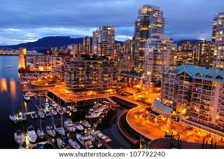 Night scene of modern buildings in vancouver downtown, british columbia, canada - stock photo