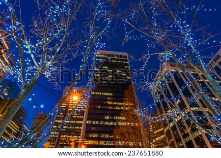 Night scene of modern colorful city life with skyscrapers, highrise buildings. Vancouver downtown  at night. - stock photo