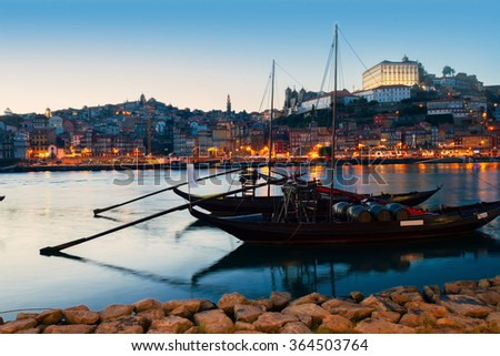 Night scene of Porto old town with  Douro river and traditional port wine boats, Portugal - stock photo