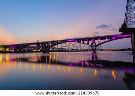 Night scene of Taipei city with a bridge over the river - stock photo