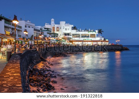 Night scene of the Playa Blanca resort, on the Lanzarote Island in the Canary Islands, Spain. - stock photo