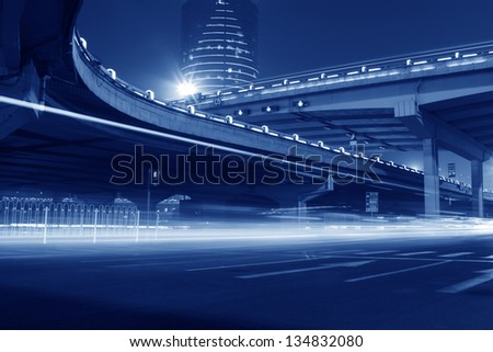 night scene of the prosperous city, under the viaduct in beijing, China - stock photo