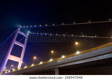 Night scene of Tsing Ma Bridge with illuminated light in Hong Kong, Asia. - stock photo