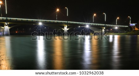 night scene with bridge over river
