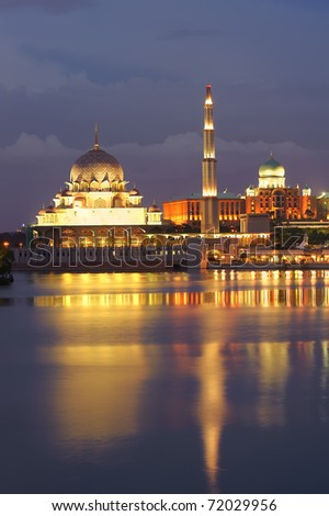 Night scene with colorful mosque and reflection on river in Putrajaya, Malaysia, Asia. - stock photo