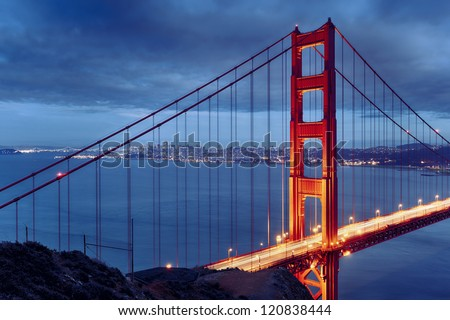 Night scene with famous Golden Gate Bridge and San Francisco lights - stock photo
