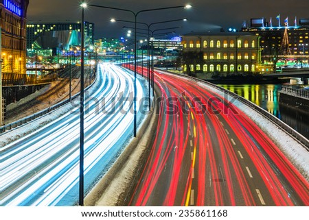 Night scenery of the Old Town (Gamla Stan) pier architecture with highway road transportation traffic in Stockholm, Sweden - stock photo