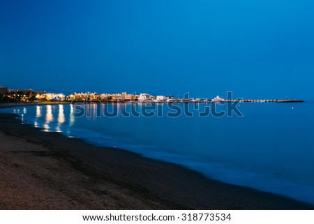 Night Scenery View Of Embankment, Seacoast, Beach In Benalmadena. Benalmadena is a town in Andalusia in Spain, 12 km west of Malaga, on the Costa del Sol. It caters for a large number of tourists. - stock photo
