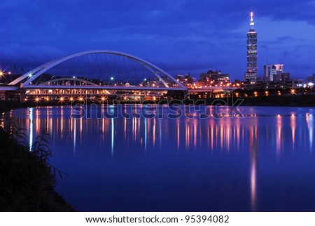Night scenes of the Taipei city with the bridge and beautiful reflection - stock photo