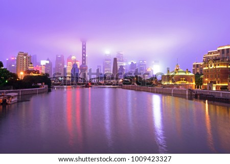 night shanghai skyline with reflection ,beautiful modern city