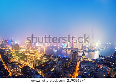 night shanghai skyline with reflection ,beautiful modern city - stock photo