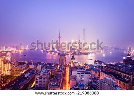 night shanghai skyline with reflection ,beautiful modern city - stock photo