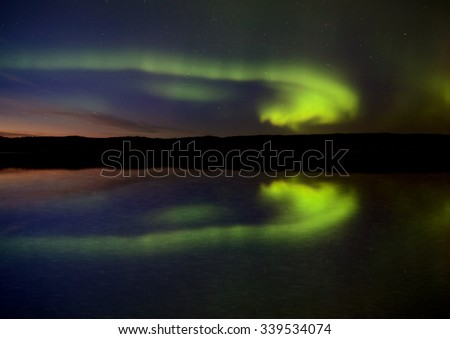 Night Shot Northern Lights Saskatchewan Canada lake reflection - stock photo