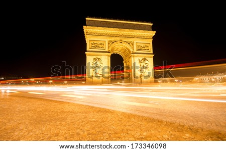 Night shot of Arc de Triumph in Paris shot at long exposure - stock photo